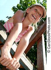 Playground - Young girl climbing