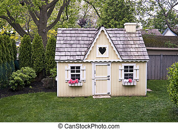 child's playhouse in the backyard