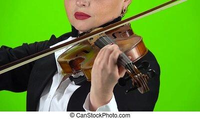 Playing a violin close up. Green screen - Playing the violin...