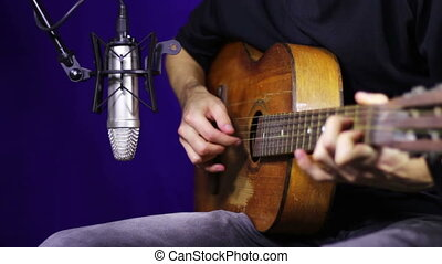 Playing Acoustic Guitar in Studio