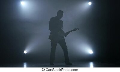 Playing an electric guitar in the performance of musician