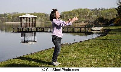 playing ball near a lake