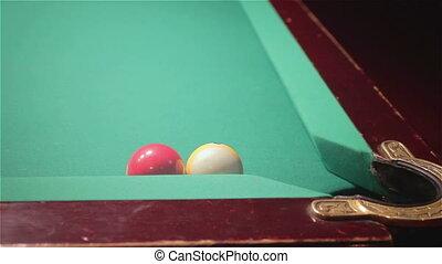 Playing billiard .Close-up shot of a man playing billiard