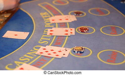 playing blackjack in casino with dealer