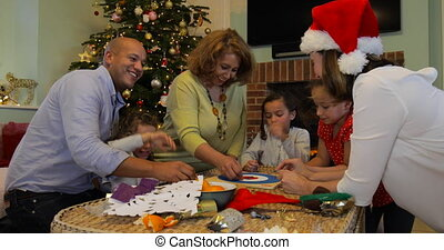 Playing Board Games At Christmas - Family are playing board...