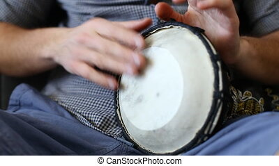 Playing Bongo drum close up HD stock footage. Hand tapping a Bongo drum in close up.
