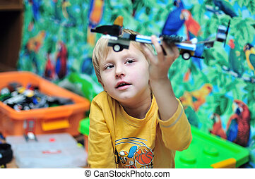 playing boy - little boy made a plane from constructor and...