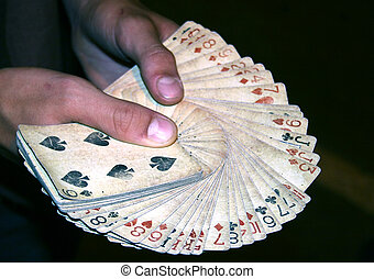 playing card in hand