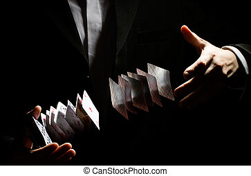 playing-card trick - A man showing a playing-card trick