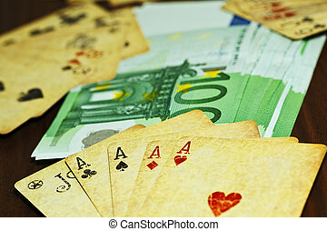 Playing cards and euro money on the table