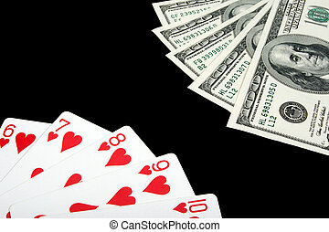 Playing cards and money on black background