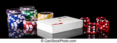 Playing cards, dice and Poker Chips in front of Black, Concept gambling and Casino
