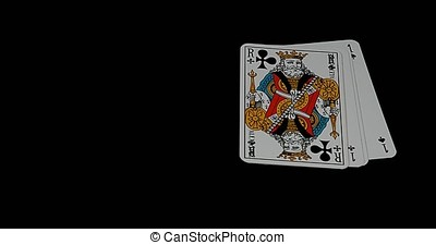 Playing Cards, Four Aces and One King falling againt Black...