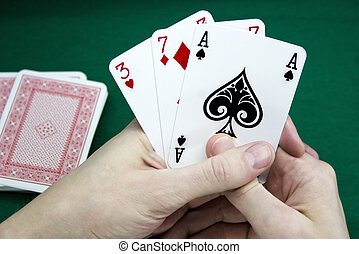 Playing cards in a hand
