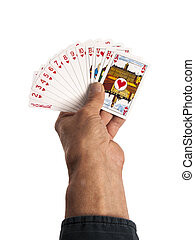 playing cards in hand as a background