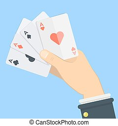 Playing cards in hand.