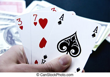 playing cards in his hand