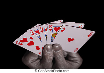 Playing cards in the silver hands