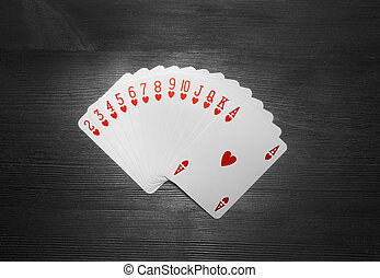 Playing cards isolated on black background