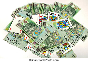 playing cards mixed with money