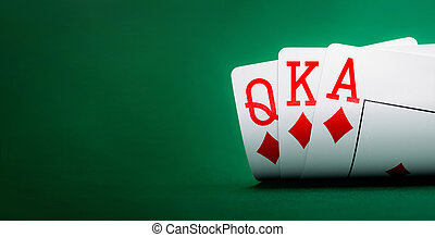 playing cards on a green table