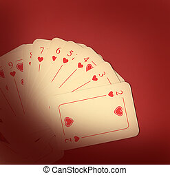 Playing cards on red