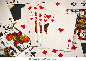 Playing cards on the background of scattered cards.