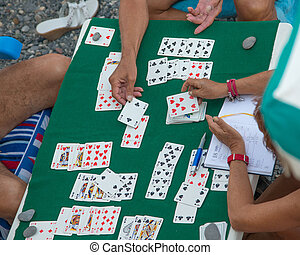 playing cards on the beach