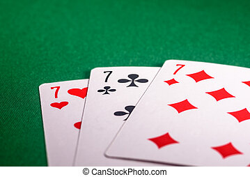 Playing cards on the green table