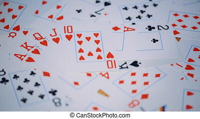 playing cards scattered on a table