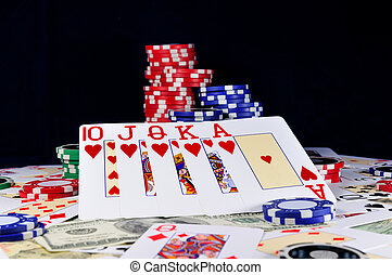 playing cards with gambling chips and money