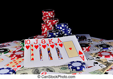 cards with gambling chips and money