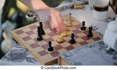 Playing chess outdoors arranging pieces