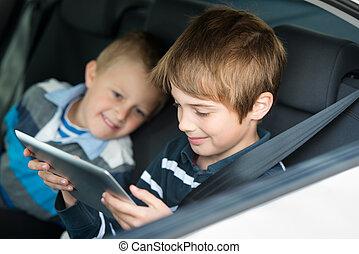 Playing children - Children playing through ipad touchscreen...
