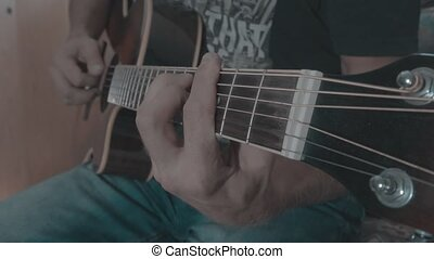 Playing chords on acoustic guitar
