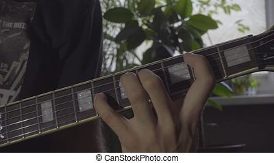Playing chords on electric guitar
