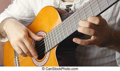 Playing classic spanish guitar