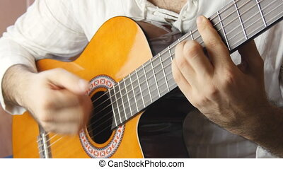 Playing classic spanish guitar - Closeup view of playing...
