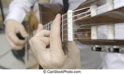 Playing classical guitar