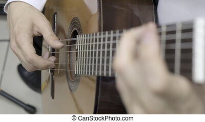 Playing classical guitar. Slow motion