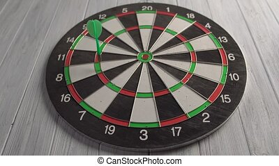 Playing Darts on White Wood Wall Indoor