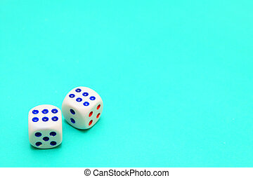 Playing dices on cloth.