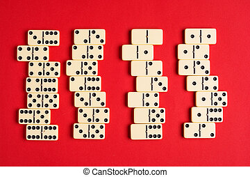 Playing dominoes on a red table. flat lay background. - ...