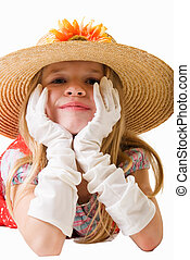 Playing dress up - Cute little blond eight year old girl...