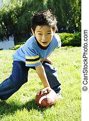 Playing football - A boy having fun playing football
