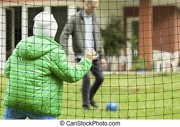 Playing football in a garden