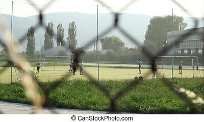 Playing Football in Neighborhood - Kids playing football in...