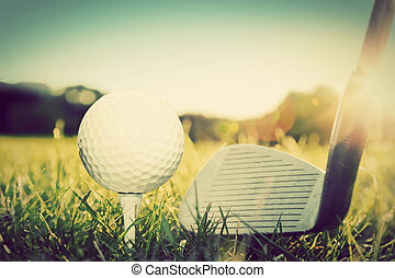 Playing golf, ball on tee and golf club. Vintage, retro...