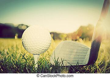 Playing golf, ball on tee and golf club. Vintage, retro...