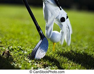 Playing golf, ball on tee